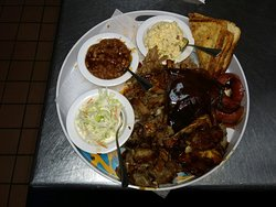 BBQ platter for two with pulled pork, smoked ribs, smoked brisket, and chopped chicken.