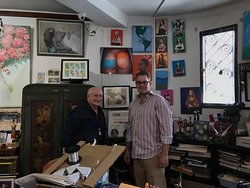Owner Carlos Weil (left) & artist Scott Crystal (right) with the artist's photo in the backgroun