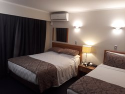 Main bedroom with a kingsize bed plus a single bed