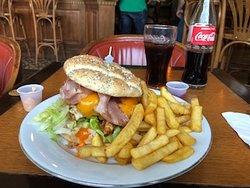 Huge hamburger with fries freshly grilled, glad they have bottled coke