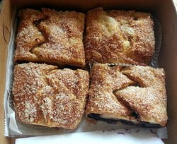 one peach, one apple, one cherry & one blueberry strudel slices