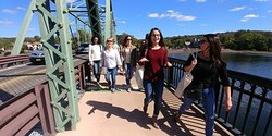 Tour guests walking over the Lambertville-New Hope Bridge on the Delaware River