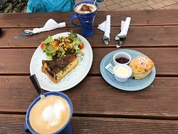 quiche with side salad, a scone, and lattes
