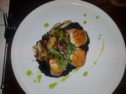 Pan seared Scallops, squid ink risotto.