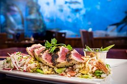 Wood Grilled Yellowfin Tuna with coconut, lemongrass, lime vinaigrette, crab fried rice