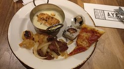 buffet selection: sushi, salmon, shrimps and a slice of pizza