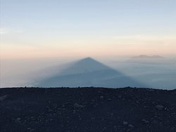 Pyramid shadow cast by Semeru at sunrise