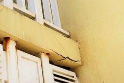 Broken concrete under balcony