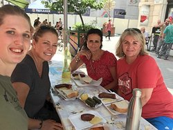 Local sausage time during The walking Pest tour