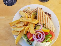 Steak and stilton pannini with chips and salad