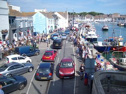 Custom House Quay runs down the northern side of Weymouth's Lower Harbour on a hot Summer aftern