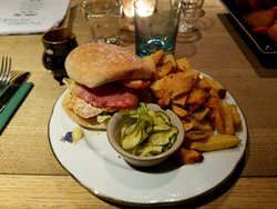 chicken/bacon sandwich with chips and pickles