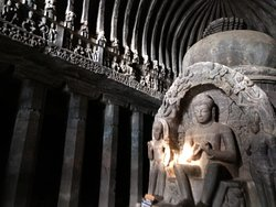Image of Buddha inside the Chaitya Griha (Cave 10) with the roof carved like wooden beams.