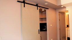 Sliding dividing door. Divides Bedroom from Living Room/Kitchenette