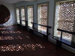 Cardboard art in the windows at Hancock Shaker Village