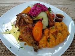 Cornish hen served with sweet potato mash and garden salad