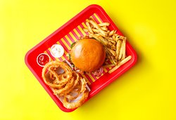 Wowburger with a side of fries and onion rings
