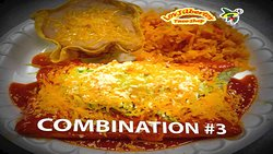 BEEF OR CHICKEN: Topped with Enchilada Sause, Cheddar Cheese, and EnchiladoCheese. Served with