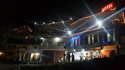 Hotel Uttaranchal Inn night view of 2 block
