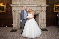 Father & Bride in front of 14 century fireplace.