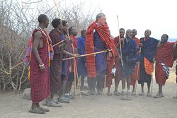 That's a Maasai Tribe found in Tanzania the most powerful tribes that based on Animal keeping and they nomally played a nomadic role actually they don't dwell in one place but always move from one place to another in search for pasture and water for their animals that's their traditional life of living and unique style of wearing clothes and Dancing with stick and they normally get married along their tribes non from other tribes very rare from other tribe apart from a maassai tribe.