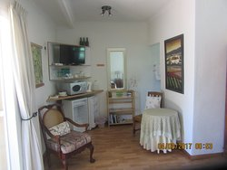Garden Chalet with semi-self catering. Sleeps 2. Undercover parking