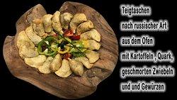 Teigtaschen (Pierogi) aus dem ofen, mit Fleischfüllung, oder nach russischer Art.