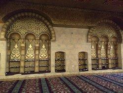 Shelves with many koran on.