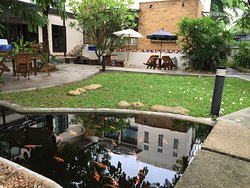 The garden is in front of healthy grocery and coffee shop where client can sit and relax.