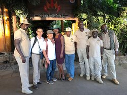 Our MD Winfred Akinyi and our drivers posing for a photo after safari