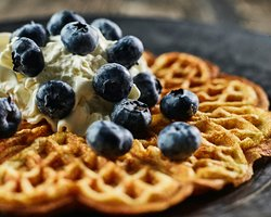 Taste the delicious waffle with blueberry at the Sirmakko Reindeer Farm in Rovaniemi, Lapland, Finland