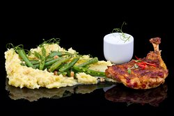 Spicy maize chicken with wok snow peas and nuts with mashed potatoes
