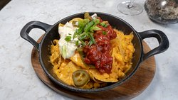 Steakhouse Nachos jalapeño, salsa, grated cheddar + sour cream