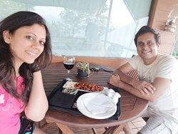 Sneha Shukla and Shalin Shukla Dining on porch at Camp Della Resort, Lonavala
