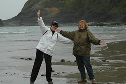 Friends enjoying Heceta Beach in a light misty rain. Any day is a good day here!