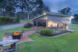Fantastic recreation area with kitchen, BBQ, seating for 20 and a terrific fire-pit!
