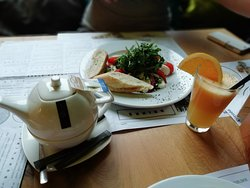 Italian breakfast with freshly squeezed orange juice and tea.
