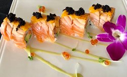 SALMON LOVER ROLL 生🌶 Salmon, avocado, mango inside, torched salmon,  topped with spicy sauce