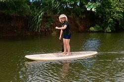 Paddle boarding up the river on the North Shore is always a great way to spend time during Your Private Tours.