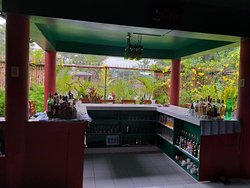 A well stocked cocktail bar, with views of the volcano