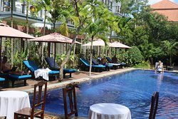 Out door swimming pool where you spend your day rest after long time journey Angkor Wat tour.