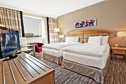 Our contemporary rooms are decorated in cool, calm tones and have soundproof windows.
