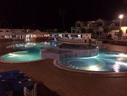 Nighttime Pool area looking towards reception