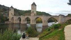 Pretty stone bridge over a wide river