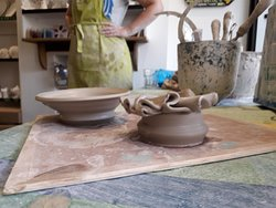 On the left - delightful bowl by Evan aged 12. Left - was a vase, then a bowl and ended up as a candlestick holder by Tara aged 40 something (lots of somethings).....