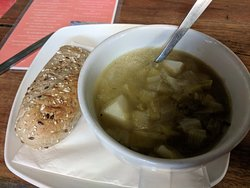 Homemade leek and potato soup and a warm roll
