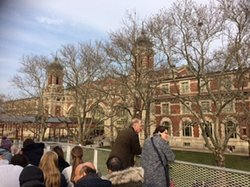 While on the return ferry from the statue of  Liberty , a must stop is this Ellis Island . 100 years ago, when immigrants started pouring in US   , they had to enter through this port . Their original baggage, clothes , some recorded conversations are for all to see . It makes a poignant  viewing .