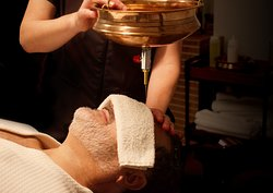Enjoy Shirodhara, an Ayurvedic oil massage with therapeutic benefits that calm the mind of stress.