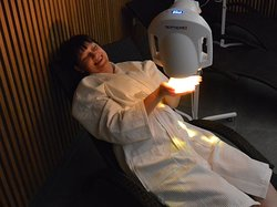 Light therapy room with Bioptron lamps.