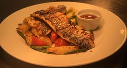 Grilled Sea Bass Fillet, comes with juicy fried Baby Potato and Sweet and Sour Chilli Sauce, have a dressing of Caramelised Onion and fried Fresh Green Beans is just for; £11.95